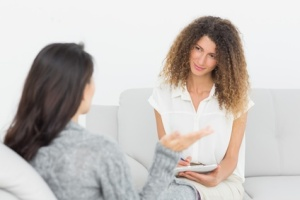 Therapist listening to her talking patient