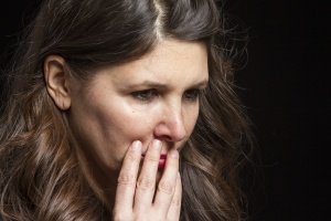 Studio portrait of a worried Caucasian female