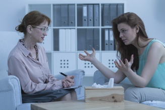 Woman discussing with psychologist